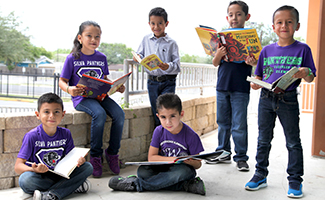 Group of students reading